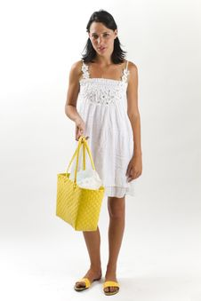 Woman In White Summer Dress With Shopping Bag Stock Photo