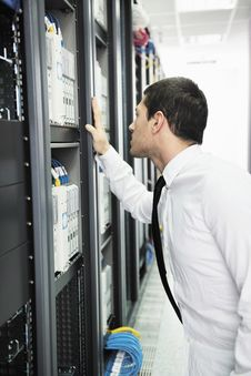 Free Young It Engeneer In Datacenter Server Room Stock Image - 18039241