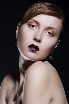 Beautiful Woman Wearing Jewelry Stock Image