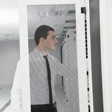 Young It Engeneer In Datacenter Server Room Royalty Free Stock Photo
