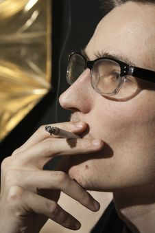 Free Pensive Young Man In Glasses With A Cigarette Stock Images - 18039884