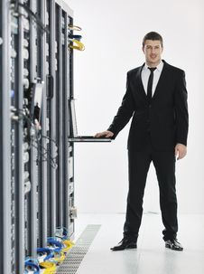 Free Young It Engeneer In Datacenter Server Room Royalty Free Stock Photos - 18040558