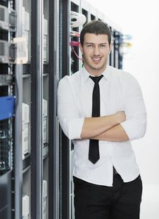 Free Young It Engeneer In Datacenter Server Room Royalty Free Stock Photography - 18041957