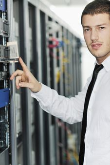 Free Young It Engeneer In Datacenter Server Room Royalty Free Stock Photography - 18042007