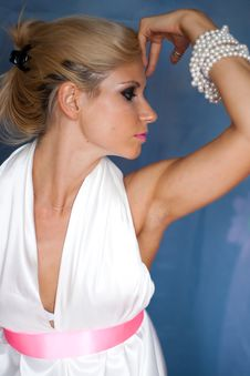 Sexy Girl In White Dress With Beads Stock Photography