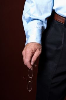 Free Business Man Holding Glasses Stock Image - 18046231