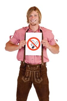 Free Smiling Bavarian Man Holds Non-smoking-rule Sign Royalty Free Stock Images - 18046889