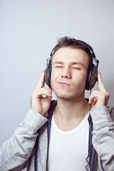 Free Guy In Headphones Stock Image - 18047111