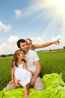 Family On Meadow Royalty Free Stock Photos