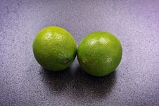 Free Two Limes On A Table Stock Photos - 18050363