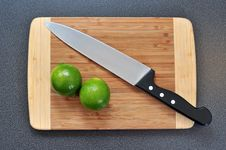 Two Limes And A Knife Stock Image