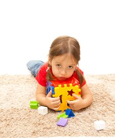 Free Isolated Cute Girl With A Plastic Toy Royalty Free Stock Photo - 18050635