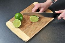 Slicing Lime Stock Photo
