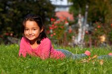 Free Little Girl Laying On Grass Royalty Free Stock Photography - 18056187