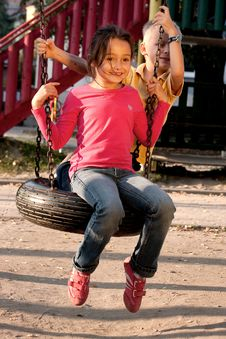 Free Boy And Girl On Swing Stock Images - 18056214