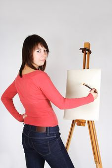 Girl Standing Near Easel And Painting Royalty Free Stock Photos