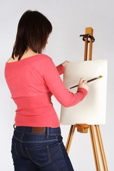 Girl Standing Near Easel And Painting Stock Photography