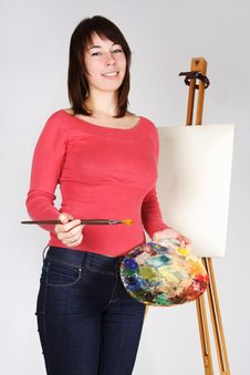 Free Girl Standing Near Easel, Holding Palette Stock Photos - 18056263