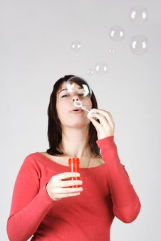 Free Woman In Red Shirt Blowing Out Soap Bubbles Royalty Free Stock Images - 18056309
