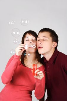 Free Man And Woman Blowing Out Soap Bubbles Stock Photos - 18056313