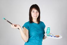Girl Standing And Holding Brush And Palette Royalty Free Stock Photos