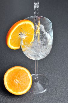 Free Pouring Water Into Glass With Orange Royalty Free Stock Photos - 18058158