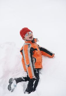 Free Boy Having Great Fun In Snow Royalty Free Stock Images - 18060099