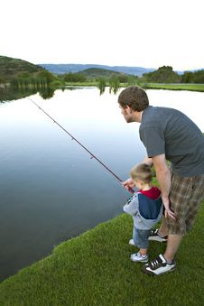 Free Father Teaching His Young Son To Fish. Royalty Free Stock Image - 18060526