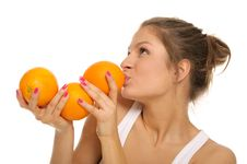 Free Young Woman With Three Oranges Stock Images - 18060694