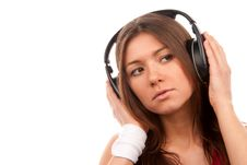 Free Brunette Young Woman Listening Music In Headphones Royalty Free Stock Photos - 18062058