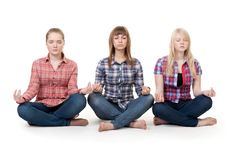 Free Three Girls Sitting In Lotus Posture Royalty Free Stock Photography - 18062077