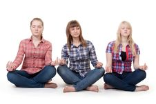 Free Three Girls Sitting In Lotus Posture Royalty Free Stock Photos - 18062128