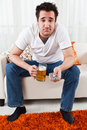 Free Young Boy With A Glass Of Beer And Remote Control Royalty Free Stock Photography - 18076237