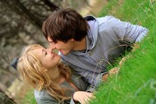 Young Cheerful Couple In The Park Stock Photos