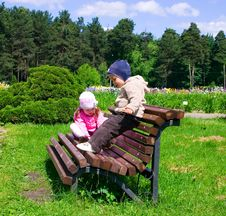 Little Boy And Girl In Park Stock Photo