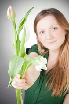 Young Blonde Girl With Tulips Royalty Free Stock Photos