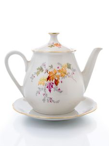 Free Empty White Teapot  On A Saucer Isolated Stock Image - 18075861