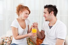 Free Young Boy And A Beauty Girl Drinking Ora Royalty Free Stock Photography - 18076247