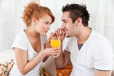 Free Young Boy And A Beauty Girl Drinking Ora Royalty Free Stock Image - 18076256