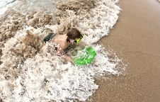 Free Boy Has Fun At The Beach Royalty Free Stock Photography - 18077587