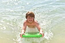 Free Boy Has Fun With The Surfboard Royalty Free Stock Photos - 18077688