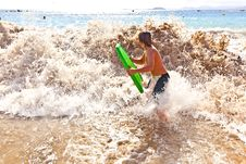 Free Boy Has Fun With The Surfboard Stock Images - 18077824