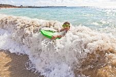 Free Boy Has Fun With The Surfboard Stock Image - 18077911