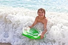 Free Boy Has Fun With The Surfboard Royalty Free Stock Photos - 18078108