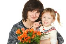 Free Grandmother And Granddaughter With Bunch Of Flower Stock Photos - 18078583