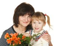 Grandmother And Granddaughter With Bunch Of Flower Royalty Free Stock Photography
