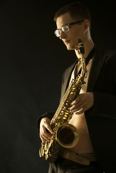 Young Jazzman With A Saxophone On Black Stock Images
