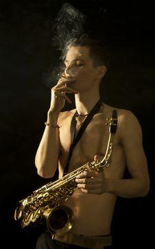 Smoking Jazz Man With Saxaphone Royalty Free Stock Images