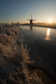 Free Old Windmill Along Frozen River Stock Image - 18080451