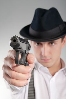 Dangerous Gangster In Hat Aims A Pistol Stock Photos